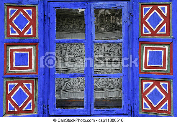 country window with vivid painted shutters  - csp11380516