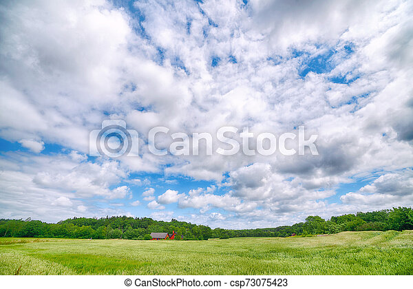 Countryside landscape with a small farm - csp73075423