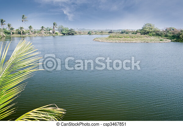 Countryside landscape with lake - csp3467851
