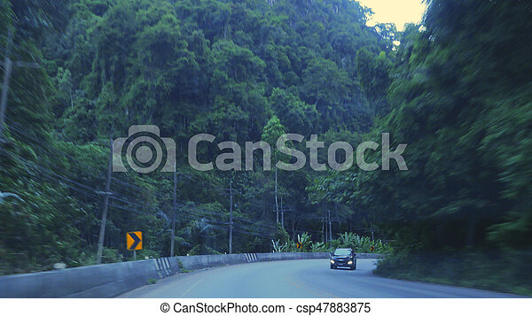 Countryside road with mountains in Asian country in the evening - csp47883875