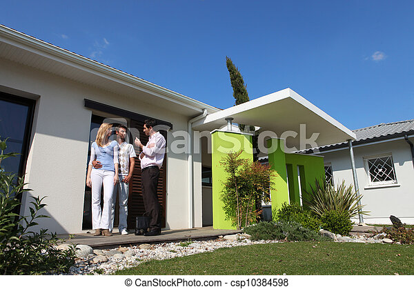 Couple and realtor visiting house - csp10384598