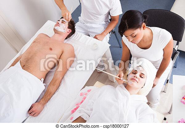 Couple Applying Facial Mask - csp18000127