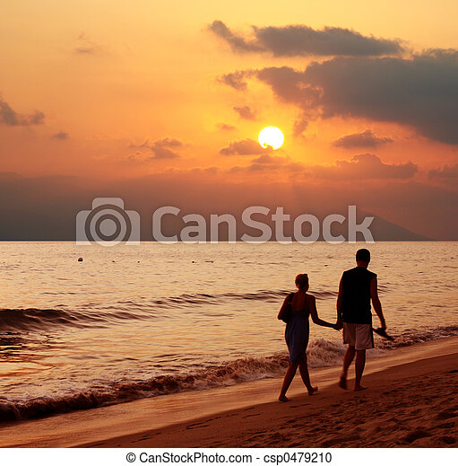 Couple at sunset - csp0479210