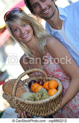 Couple buying fruit - csp8862212