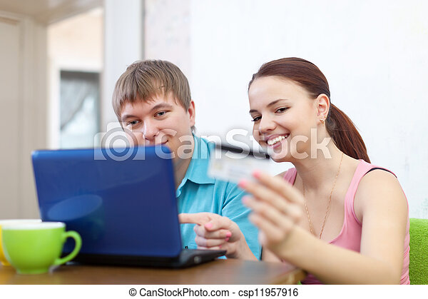 couple buying online with laptop - csp11957916