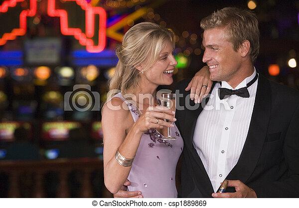 Couple celebrating in casino - csp1889869