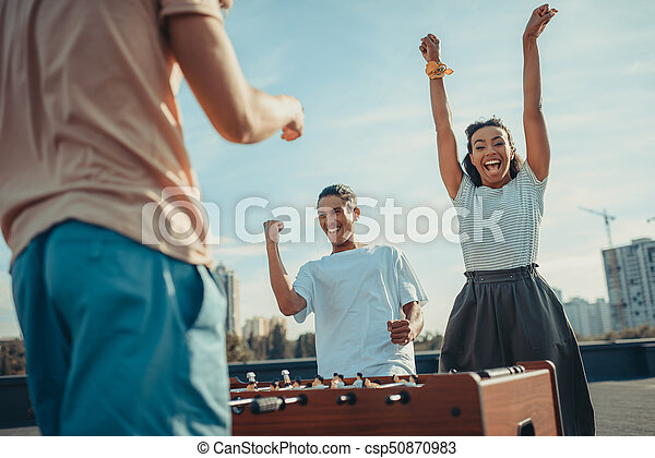 couple celebrating victory in kicker - csp50870983