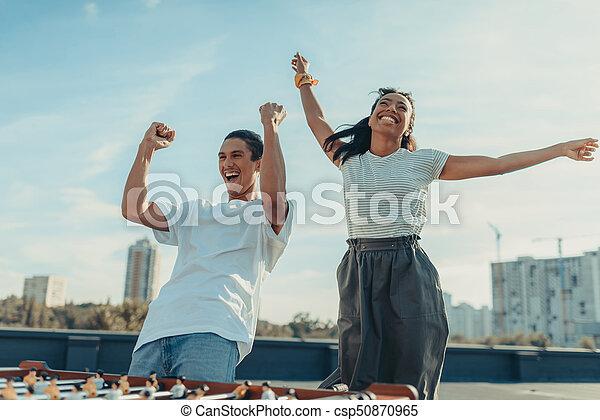 couple celebrating victory in kicker - csp50870965