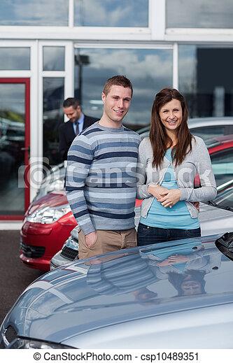 Couple choosing a car - csp10489351