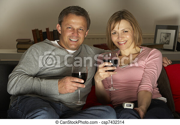 Couple Drinking Wine And Watching Television - csp7432314