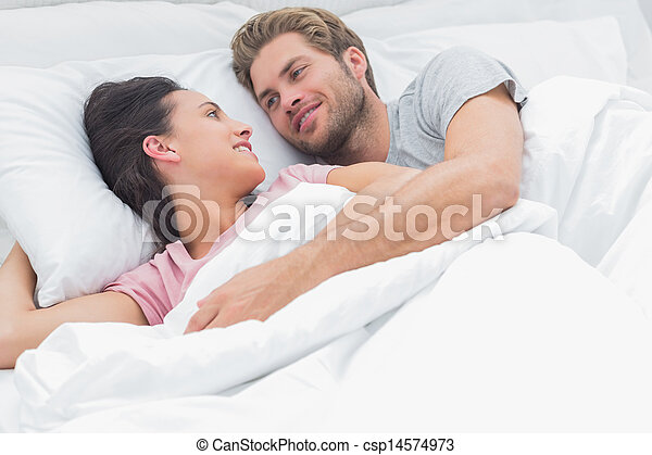 Couple embracing and looking at each other - csp14574973