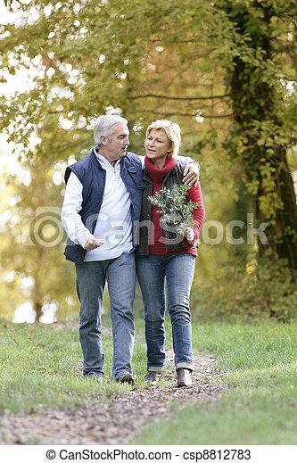 Couple enjoying romantic walk - csp8812783