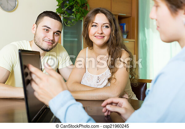 couple filling questionnaire for employee with laptop  - csp21960245