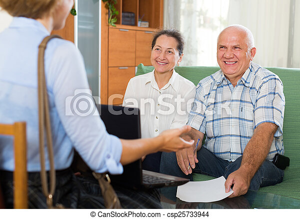 couple filling questionnaire for employee  - csp25733944