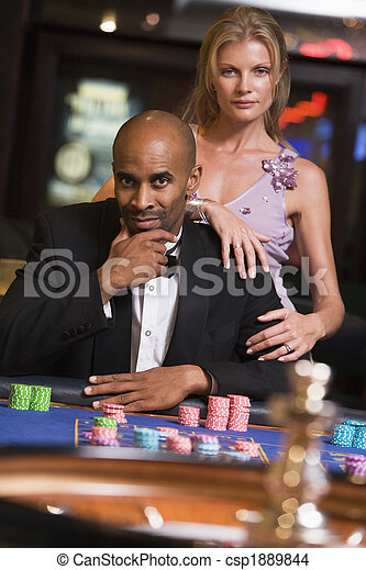 Couple gambling at roulette table - csp1889844
