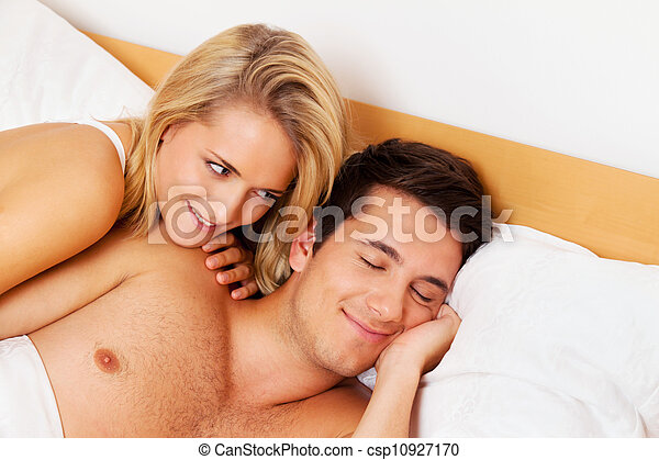 couple has fun in bed. laughter, joy and eroticism - csp10927170