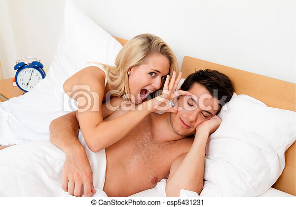 Couple has fun in bed. Laughter, joy and eroticism - csp5431231