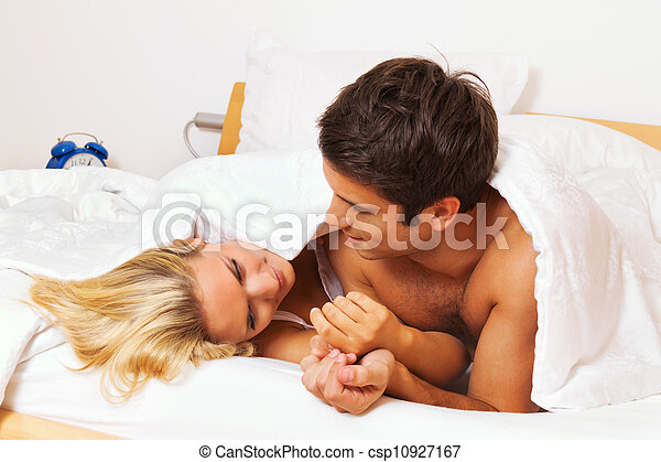 couple has fun in bed. laughter, joy and eroticism - csp10927167