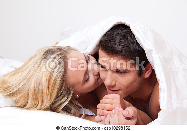 couple has fun in bed. laughter, joy and eroticism - csp10298152