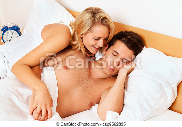 couple has fun in bed. laughter, joy and eroticism - csp9562835