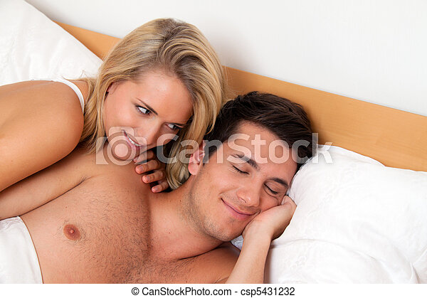 Couple has fun in bed. Laughter, joy and eroticism - csp5431232