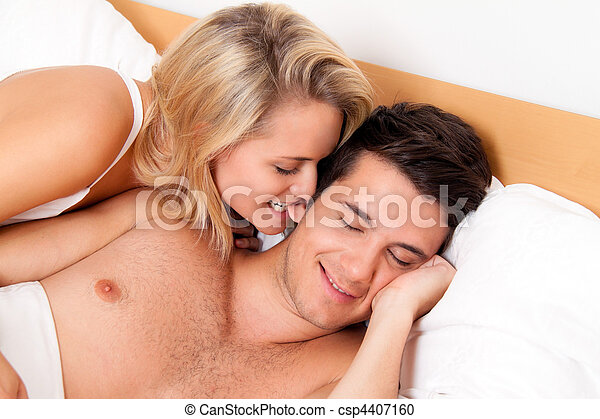 Couple has fun in bed. Laughter, joy and eroticism - csp4407160