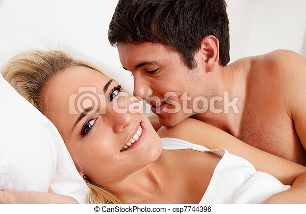 couple has fun in bed - csp7744396