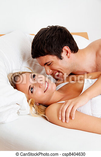 couple has fun in bed - csp8404630