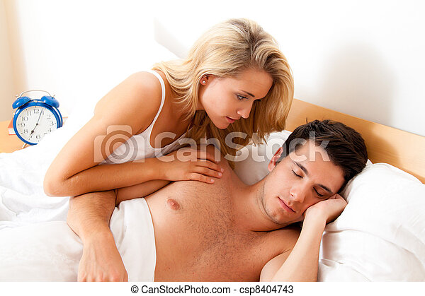 couple has fun in bed. - csp8404743