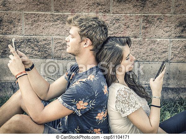 couple has fun with smartphone - csp51104171