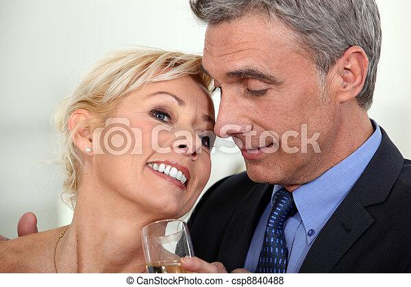 Couple having a celebratory drink - csp8840488