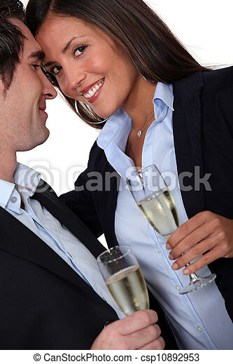 Couple having a celebratory drink - csp10892953