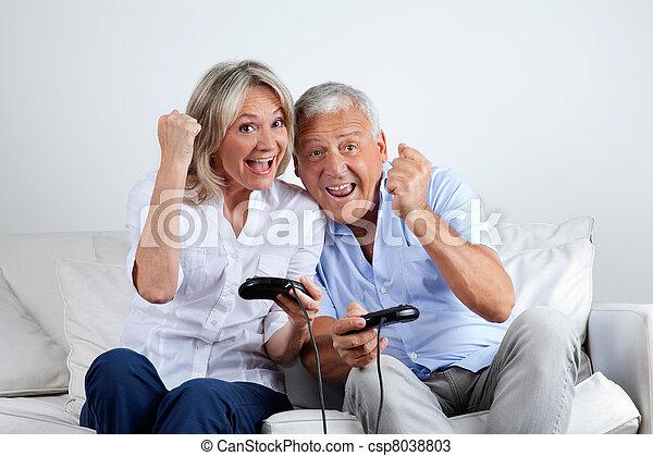 Couple Having Fun Playing Video Game - csp8038803