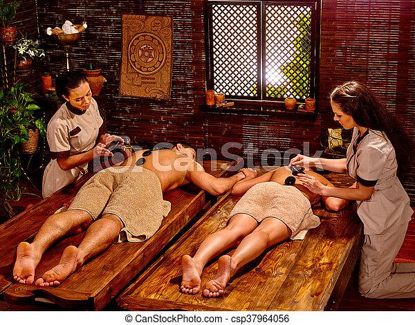 Couple having stone massage. - csp37964056