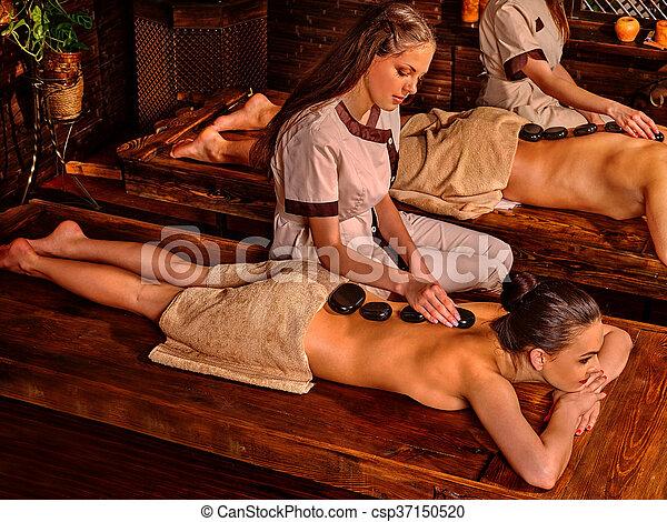 Couple  having stone massage. - csp37150520