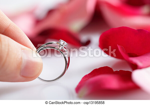 couple holding diamond ring - csp13195858