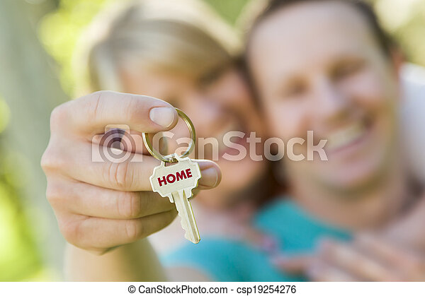 Couple Holding House Key with Home Text - csp19254276
