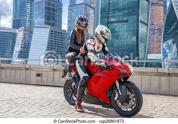 motorcycle couple pictures  Couple in a suit with a motorcycle sport bike on the background of ...