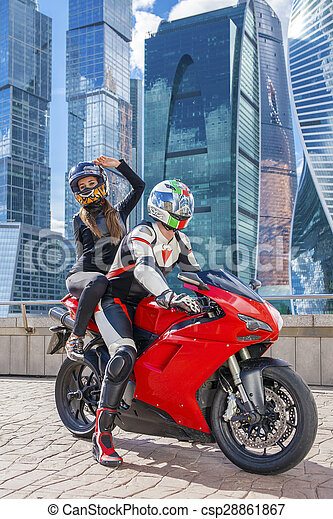 couple in a suit with a motorcycle sport bike on the background of
