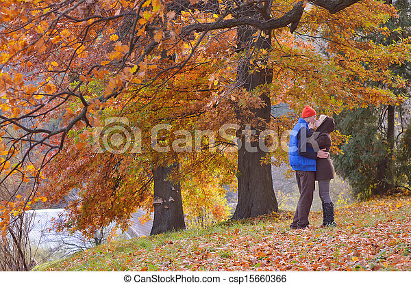 Couple in autumn park - csp15660366