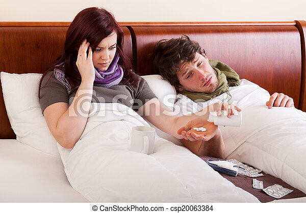 Couple in bed, ill - csp20063384