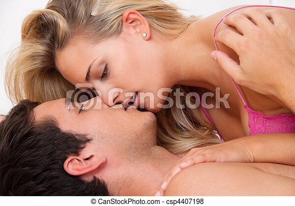 Couple in bed with sex and affection. Love and Sex - csp4407198