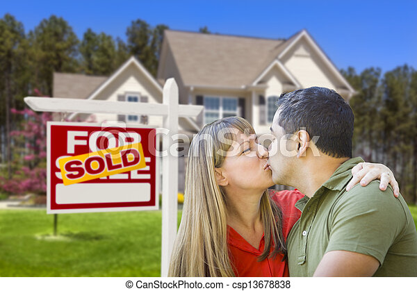 Couple in Front of Real Estate Sign and House - csp13678838
