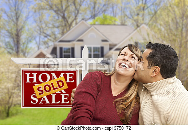 Couple in Front of Sold Real Estate Sign and House - csp13750172
