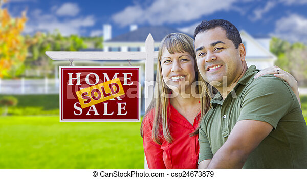 Couple in Front of Sold Real Estate Sign and House - csp24673879