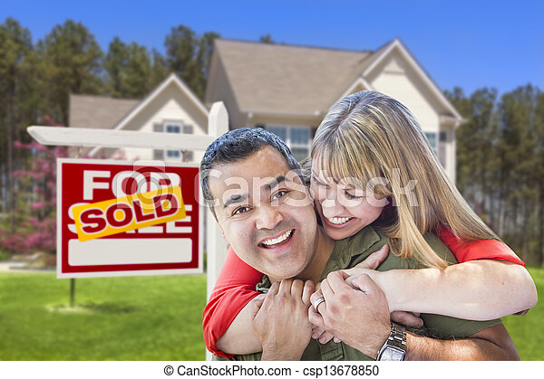 Couple in Front of Sold Real Estate Sign and House - csp13678850