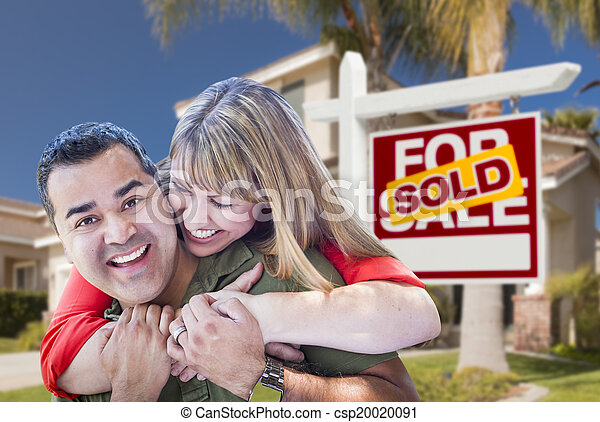 Couple in Front of Sold Real Estate Sign and House - csp20020091