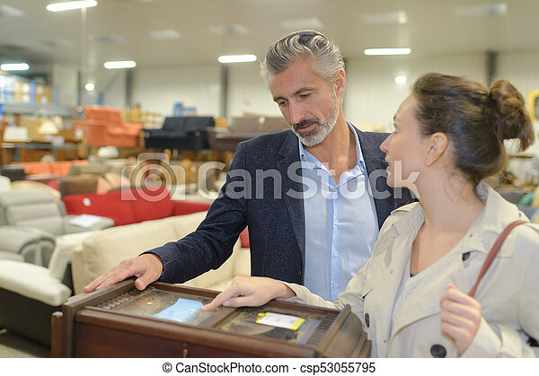 Couple in furniture store - csp53055795