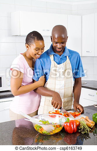 couple in kitchen cooking - csp6163749
