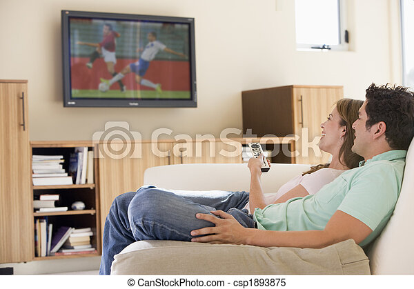 Couple in living room watching television - csp1893875